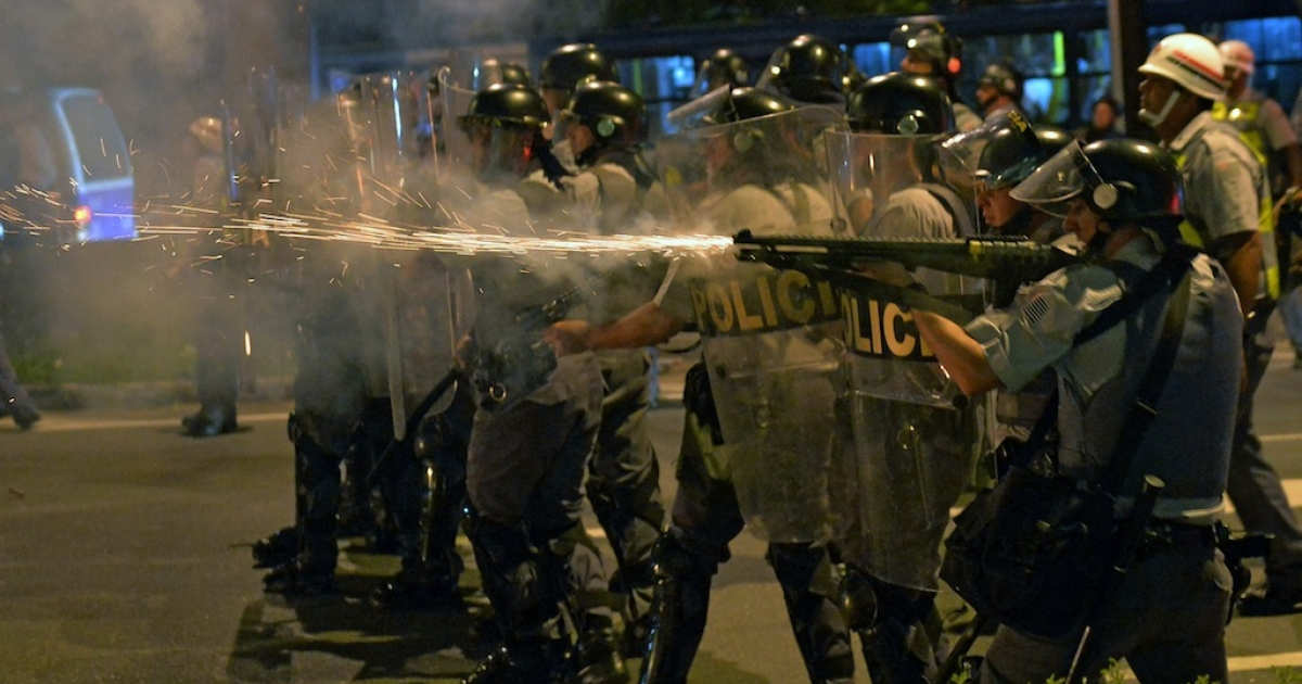 Riot police clash with demonstrators during the Teachers' Day protest on October 15, 2013, in São Paulo, Brazil.</p>