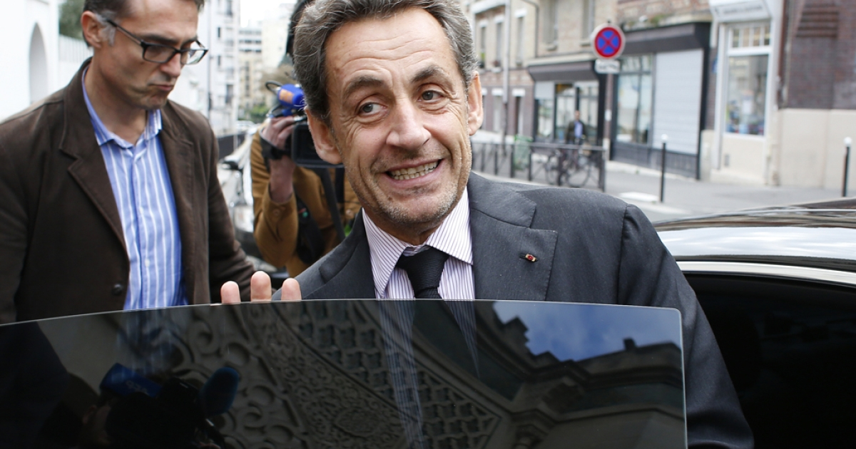 Former French President Nicolas Sarkozy leaves on October 7, 2013 Paris' Great Mosque after attending a lunch with the rector. Corruption charges against former French president Nicolas Sarkozy linked to the financing of his successful 2007 election campaign have been dropped, judicial sources told AFP on October 7.</p>