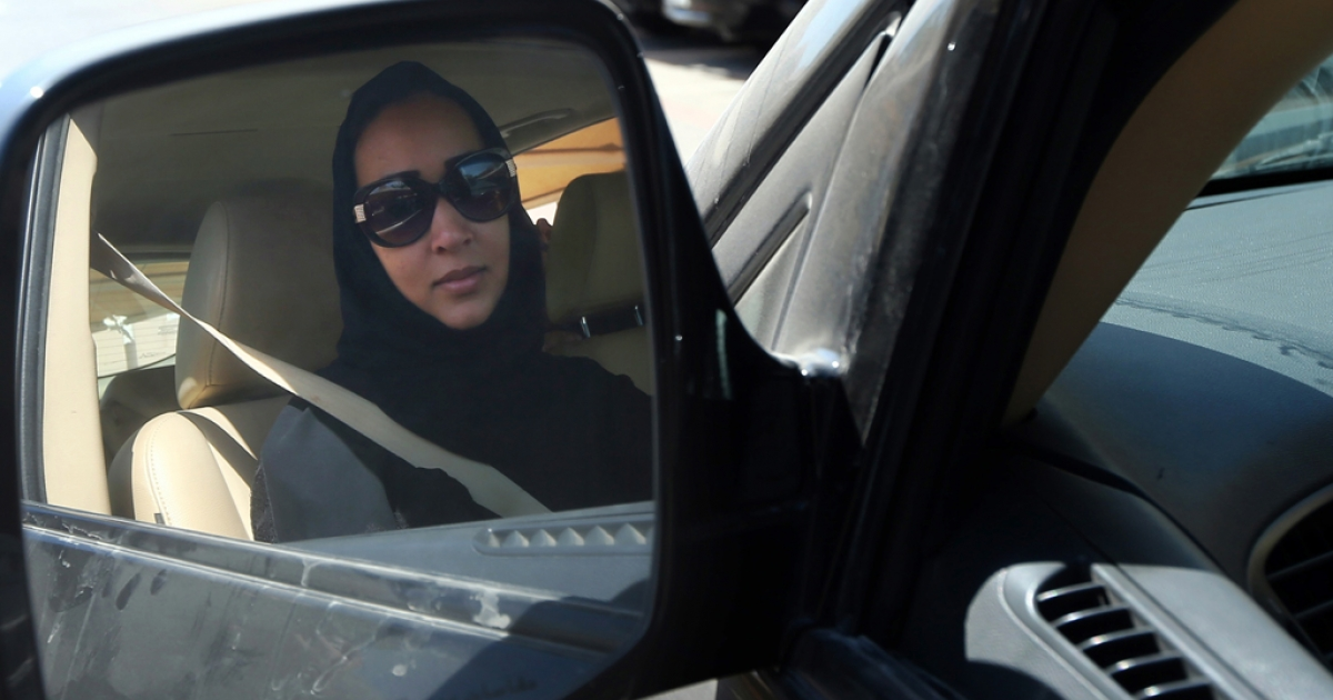 Saudi activist Manal Al Sharif, who now lives in Dubai, drives her car in the Gulf Emirate city on October 22, 2013.</p>