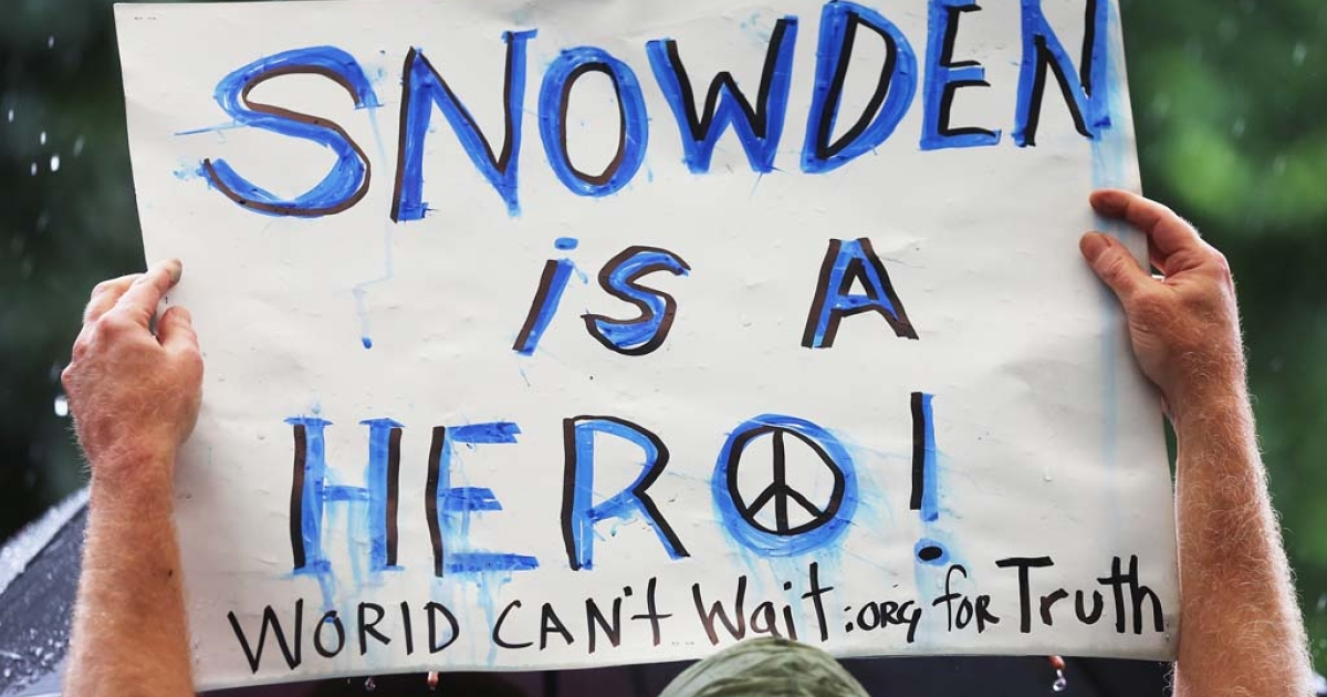 A supporter holds a sign at a small rally in support of National Security Administration (NSA) whistleblower Edward Snowden in Manhattan's Union Square on June 10, 2013 in New York City. Spying revelations via documents released by Snowden have caused serious tensions between European countries and the US.</p>
