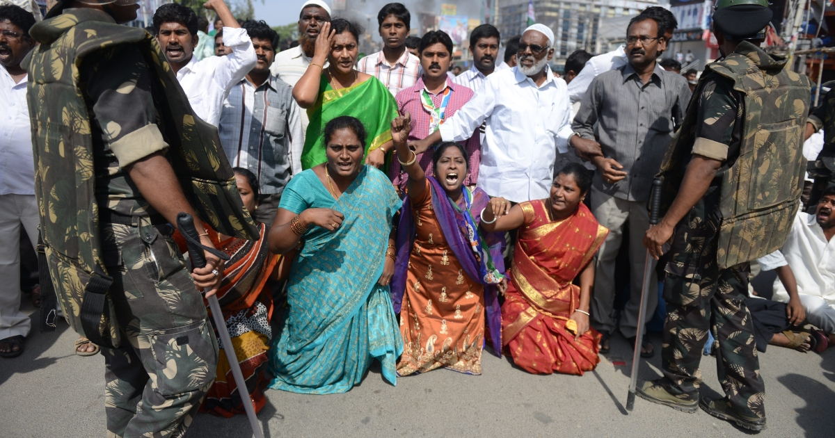 Indian supporters of united Andhra Pradesh gather on a street and  shout slogans during a protest against the formation of Telangana state, in Ananthapuram district some 400 kms from Hyderabad on Oct. 4, 2013.</p>