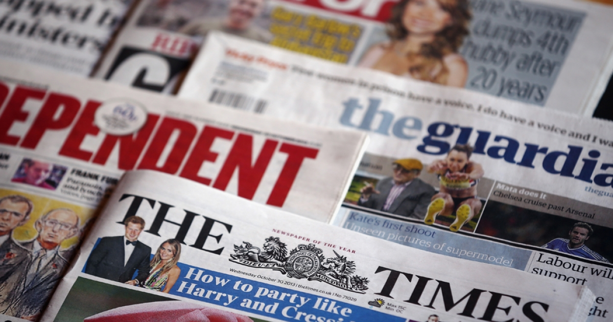 A selection of UK national newspapers displayed together on October 30, 2013 in London, England.</p>