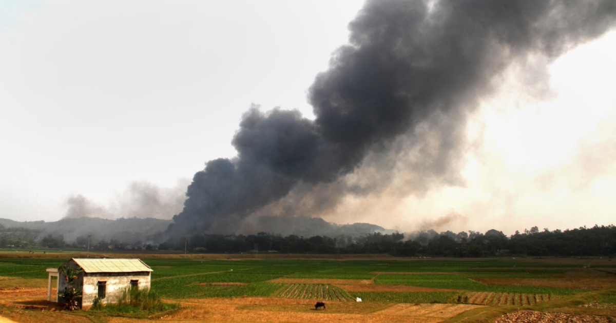 Smoke is seen rising up following an explosion at a firework factory in the northern province of Phu Tho on October 12, 2013. At least seven people died early on October 12 in an explosion at a fireworks factory within a military complex, state media reported.</p>