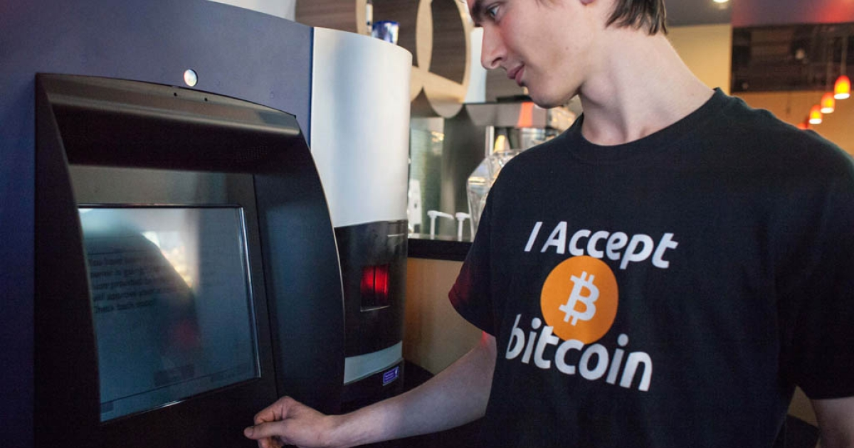 Gabriel Scheare uses the world's first bitcoin ATM on October 29, 2013 at Waves Coffee House in Vancouver, British Columbia. Scheare said he