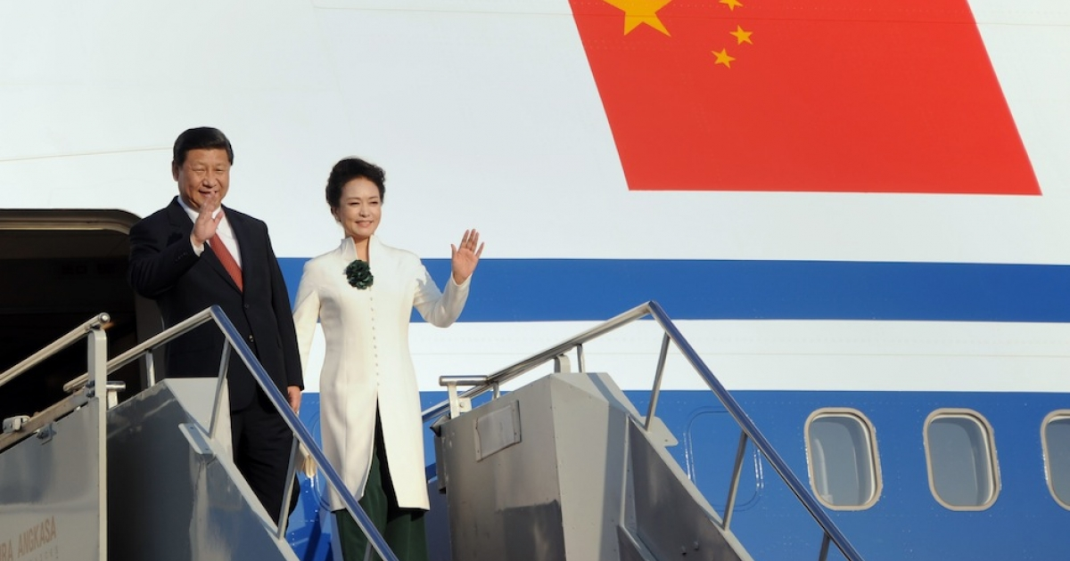 China's President Xi Jinping and his wife Peng Liyuan arrive at the APEC summit on Indonesia's resort island of Bali. President Barack Obama's cancelled trip — prompted by the government shutdown standoff — was widely seen as a victory for China. But was it?</p>