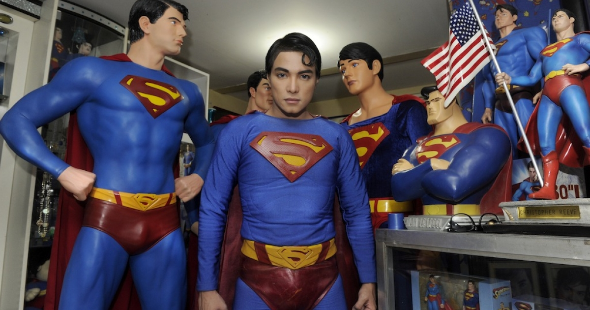 Filipino fashion designer Herbert Chavez stands dressed like comic book hero Superman among his collection of memorabilia at his home in Calamba, south of Manila, on Oct. 13, 2011.</p>