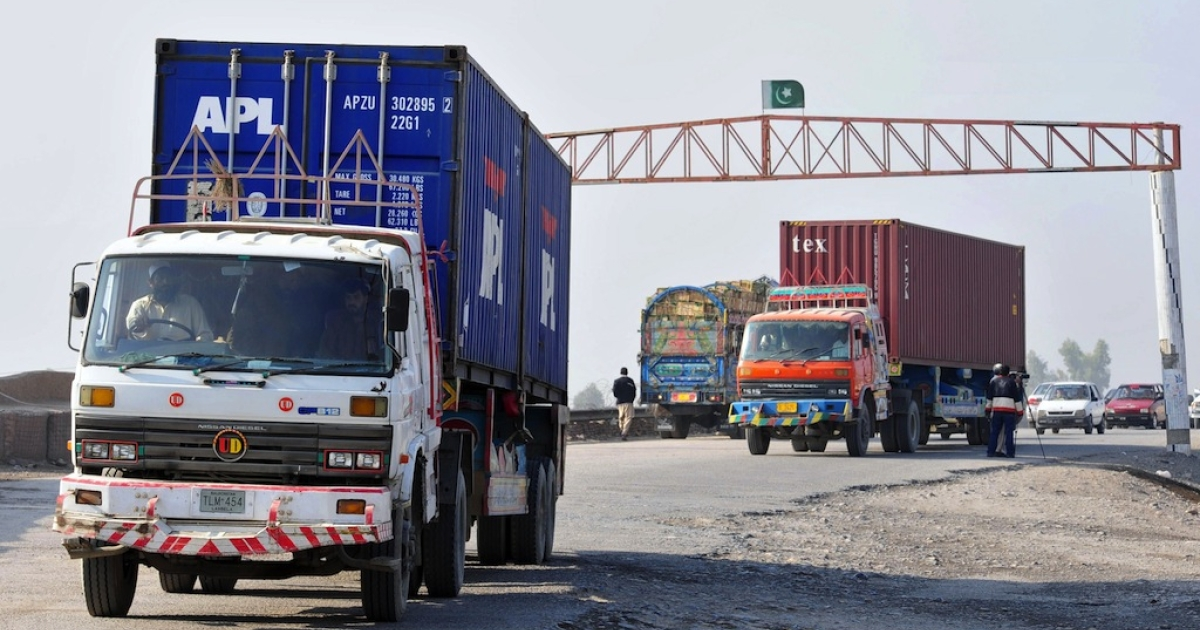 Trucks carrying supplies for NATO forces in Afghanistan return from Pakistan's Torkham border crossing on Nov. 26, 2011.</p>