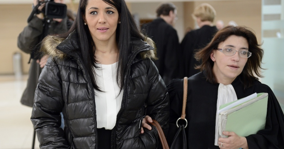 Bouchra Bagour, the mother of a three-year-old boy named Jihad who was born Sept. 11, leaves court in Avignon, France in December 2012. She faced charges after sending him to school in a T-shirt that said