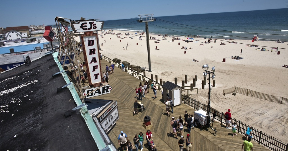 People walk by the boardwalk at Seaside Heights on the first weekend of Jersey Shore beaches re-opening to the public on May 27, 2013 in Seaside Heights, NJ.</p>