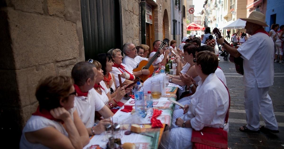 Revellers sing and play music at tables in the street after lunch during the third day of the San Fermin Running Of The Bulls festival, on July 8, 2013 in Pamplona, Spain.</p>