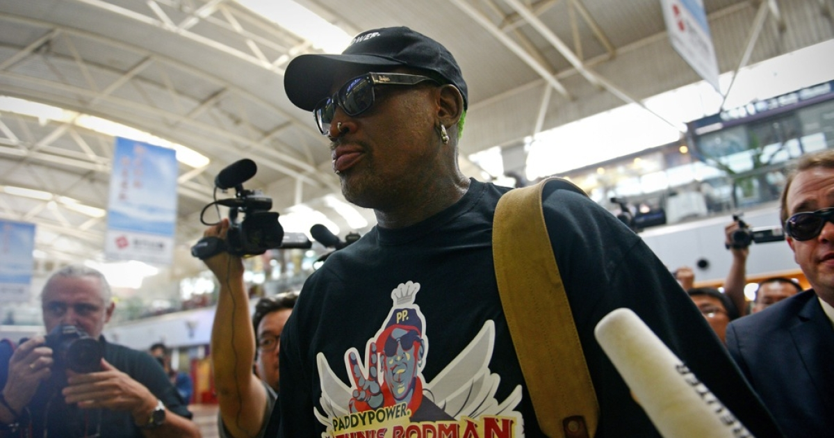 Former NBA basketball player Dennis Rodman passes through Beijing's international airport on September 3, 2013, on his way to North Korea. Rodman said he was heading back to Pyongyang to see his 'friend,' North Korean leader Kim Jong Un.</p>