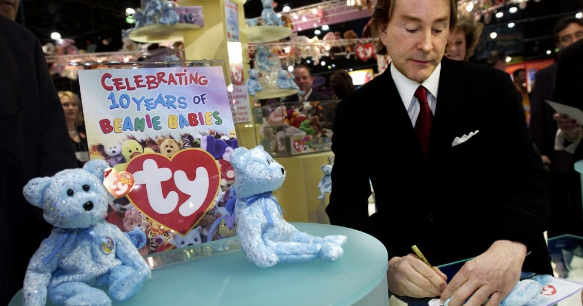 Ty Warner, creator of Beanie Babies toys, signs autographs at the American International Toy Fair in New York, February 16, 2003. The billionaire has admitted to tax evasion after prosecutors accused him of hiding some of his fortune in an offshore Swiss bank account.</p>