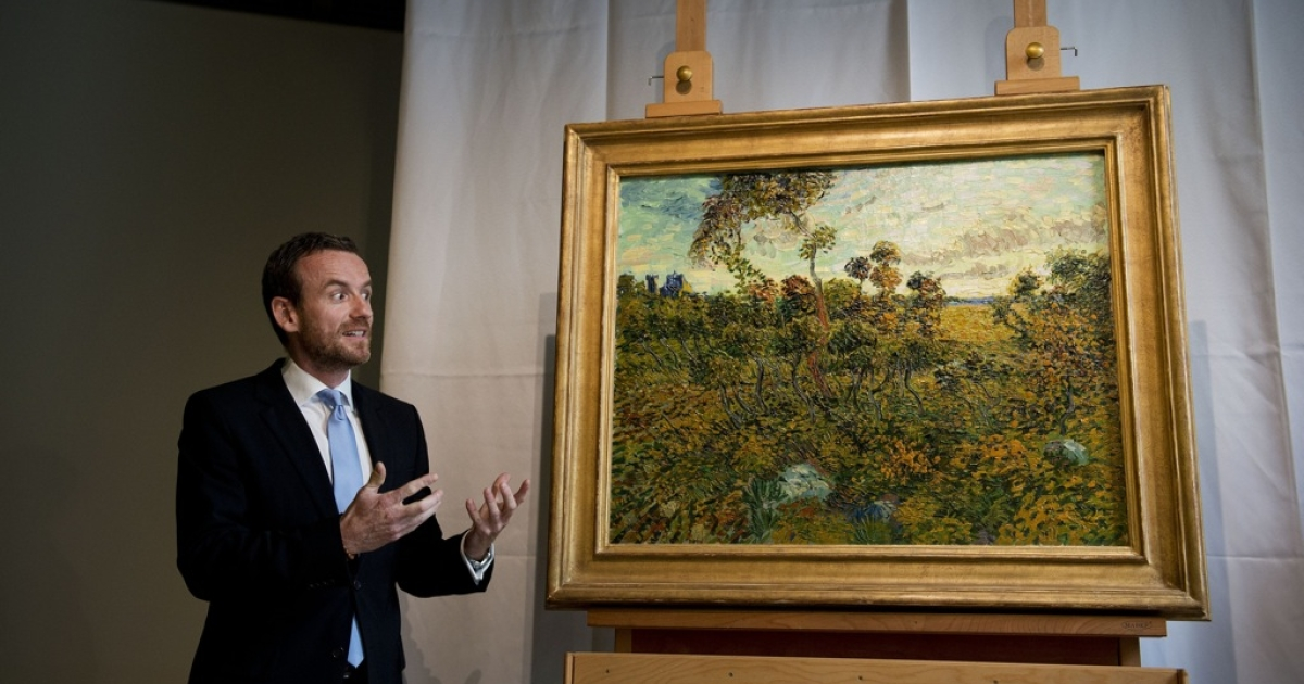 Alex Ruger, director of the Van Gogh Museum in Amsterdam, unveils a painting by Vincent van Gogh, entitled 'Sunset at Montmajour' and painted in 1888, on September 9, 2013. It had been lying for years in the attic of a Norwegian collector who thought the picture was a fraud.</p>