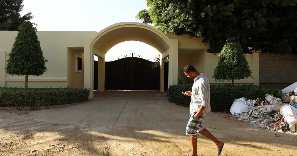 A Libyan man walks by the main entrance of the US consulate in Benghazi on September 10, 2013 on the eve of the anniversary of the 2012 attack on the diplomatic mission that left four people dead.</p>