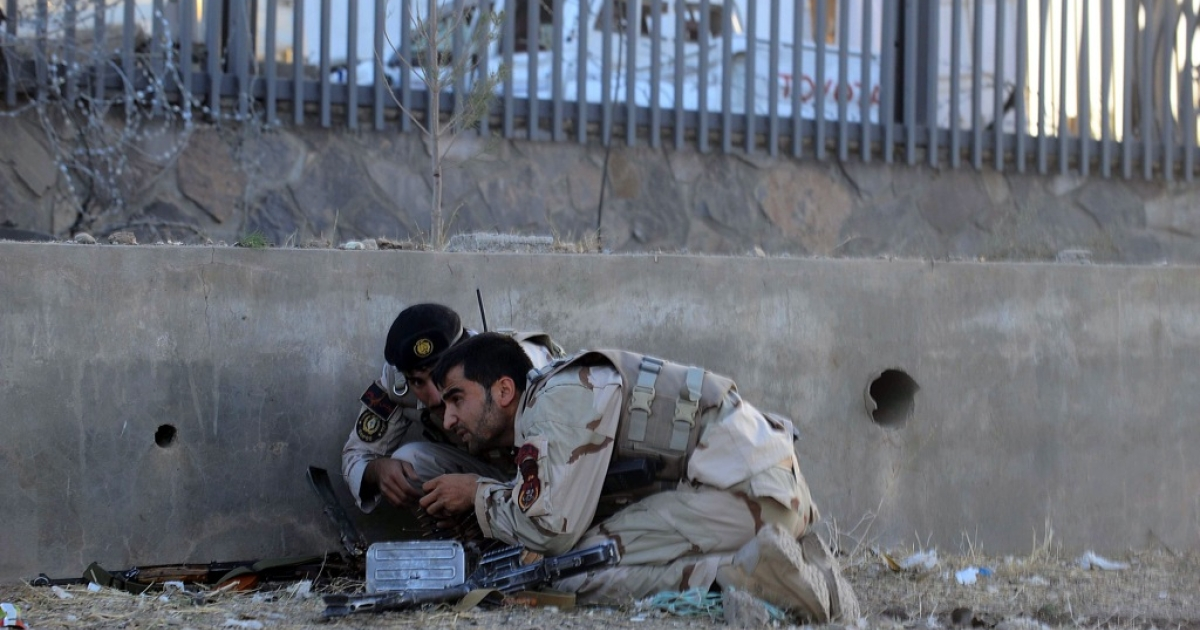Afghanistan security forces take their position during an assault on the US consulate in Herat on September 13, 2013. Gunmen staged an attack on the consulate in Herat, western Afghanistan, leaving at least three people dead and 17 wounded, officials said.</p>