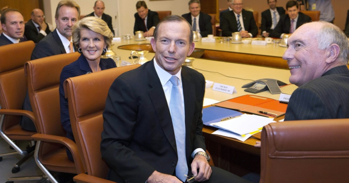 New Australian Prime Minister Tony Abbott (C) leads the first meeting of the full ministry at Parliament House in Canberra on September 18, 2013. Abbott was sworn in as Australia's new prime minister on Wednesday.</p>