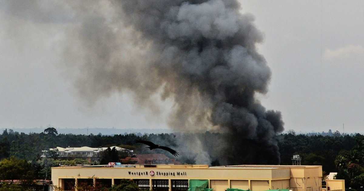 Smoke rises from the Westgate mall in Nairobi on September 23, 2013. Kenyan troops were locked in a fierce firefight with Somali militants inside the complex in a final push to end a siege that has left at least 62 dead and 200 wounded with an unknown number of hostages still being held.</p>