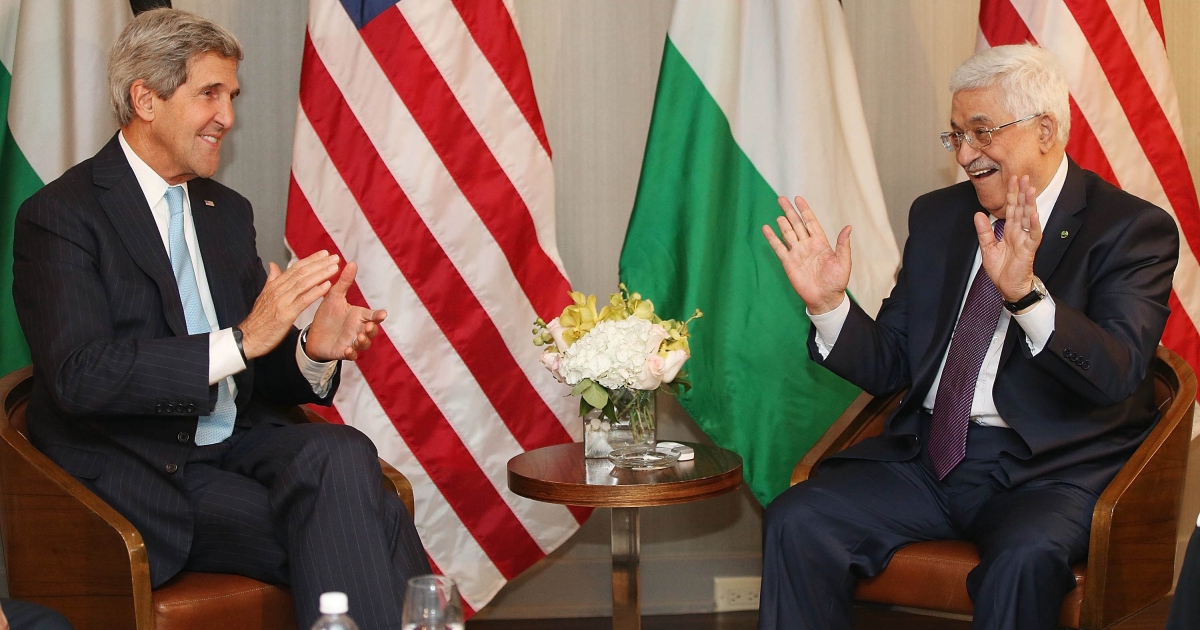 U.S. Secretary of State John Kerry (L) gestures at the start of a bilateral meeting with Palestinian Authority President Mahmoud Abbas on September 24, 2013 in New York City. Diplomats from around the world have descended on New York for the annual United Nations General Assembly.</p>