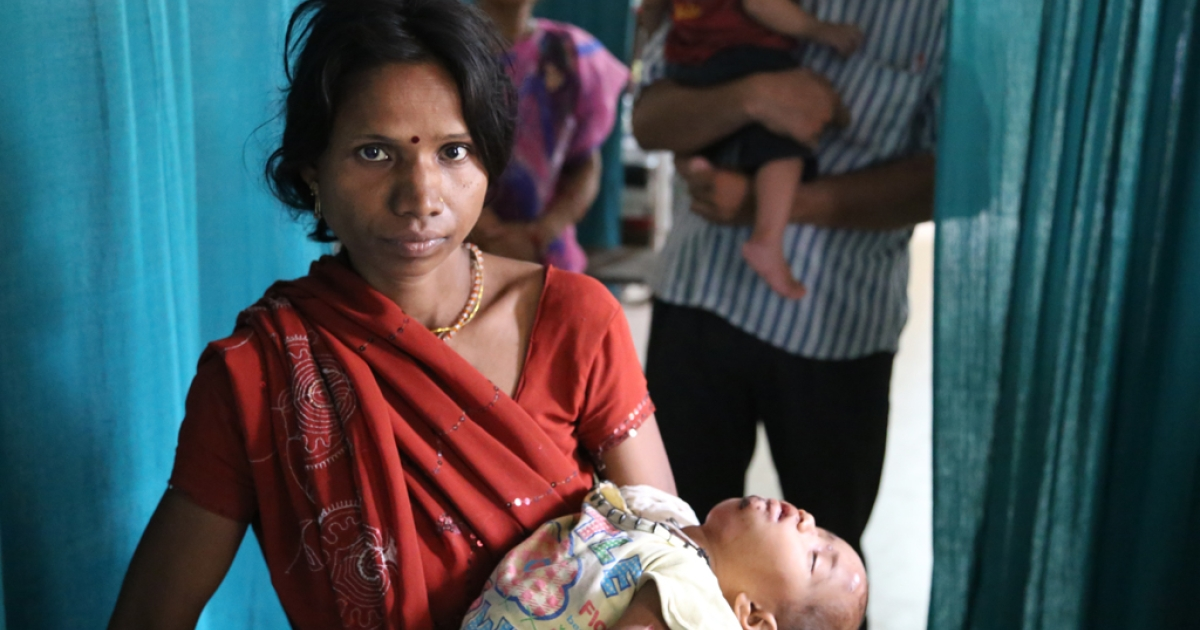 A mother with her 3-year-old daughter who suffers from chronic diarrhea and tuberculosis, at the District Hospital, Panna, Madhya Pradesh in Central India.</p>