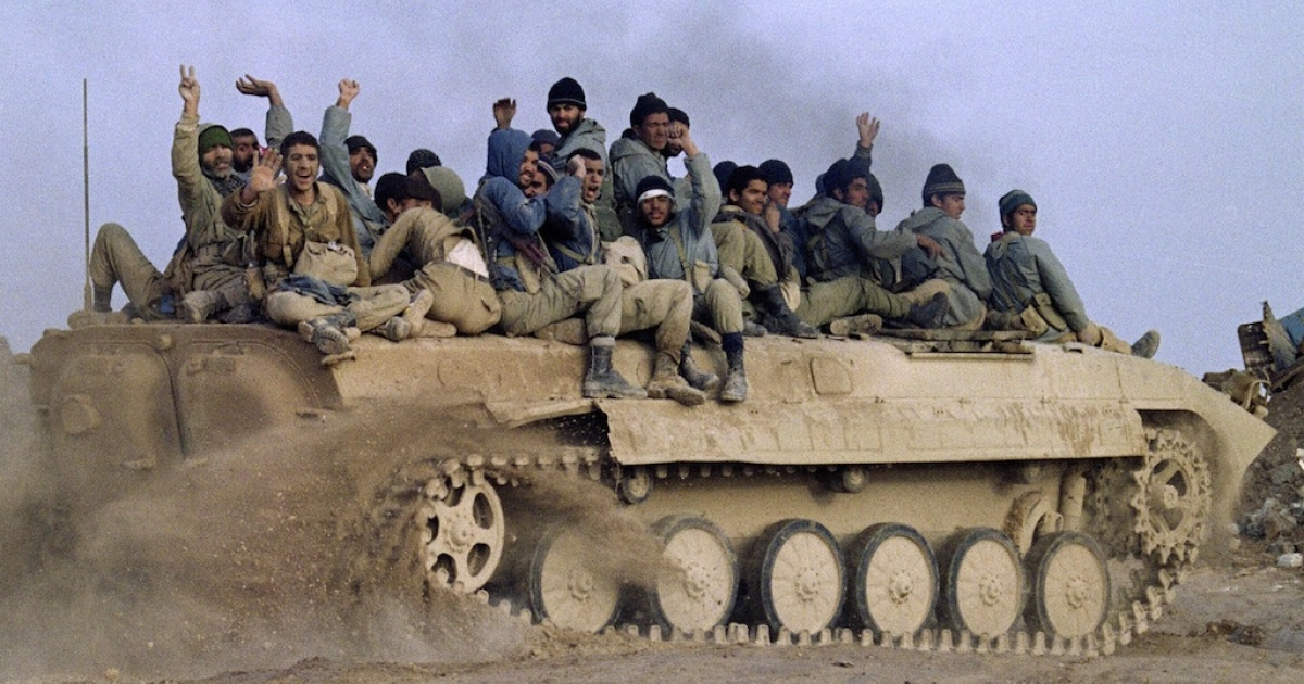 Iranian Revolutionary Guards seated on an armored personnel carrier, celebrate their victory over Iraqi troops 24 January 1987 in Bovarian Island, Iraq, located near the port of Basra.</p>
