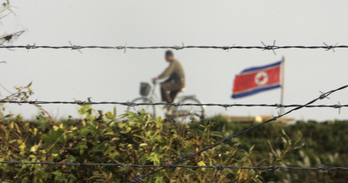 A North Korean man cycles near North Korea's border with China. The secretive nation recently allowed Western cyclists to ride through part of its northeast.</p>