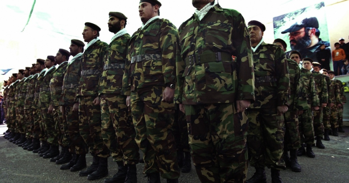 Shia Muslim militants of the Hezbollah movement stand to attention during a parade in the southern Lebanese village of Tair Debba in southern Lebanon.</p>