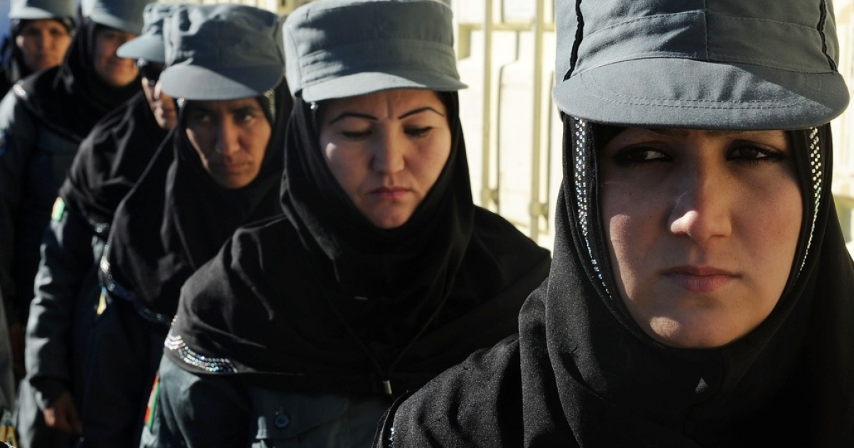 Female Afghan National Police stand at attention during a graduation ceremony at a police training center in Herat on Dec. 20, 2012.</p>