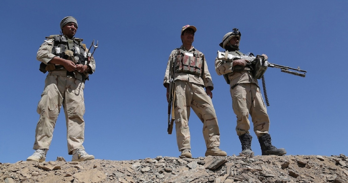 Afghan security forces stand guard in Zana Khan district in Ghazni province on Aug. 27, 2013.</p>