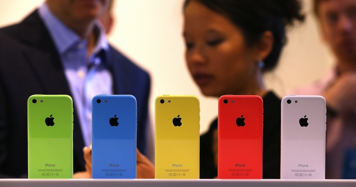 The cheaper iPhone 5C on display at Apple's Cupertino headquarters on September 10, 2013.</p>