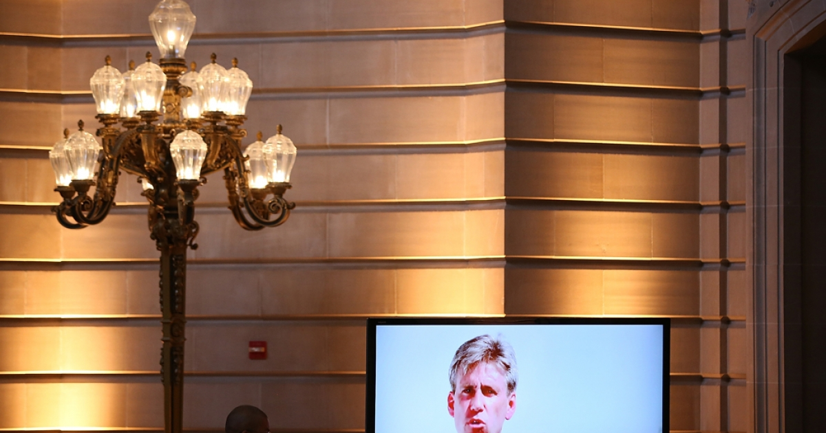 A U.S. Marine watches a video of former Ambassador Christopher Stevens during a memorial service for Stevens at San Francisco City Hall on October 16, 2012 in San Francisco, California.</p>