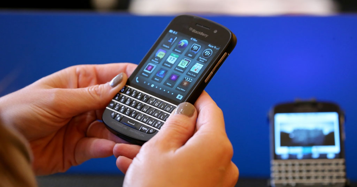 A woman looks at a Blackberry at the New York Times Schools For Tomorrow Conference on Sept. 17, 2013 in New York City. The Wall Street Journal reported on Sept. 18 that BlackBerry intended to cut 40 percent of its workforce.</p>