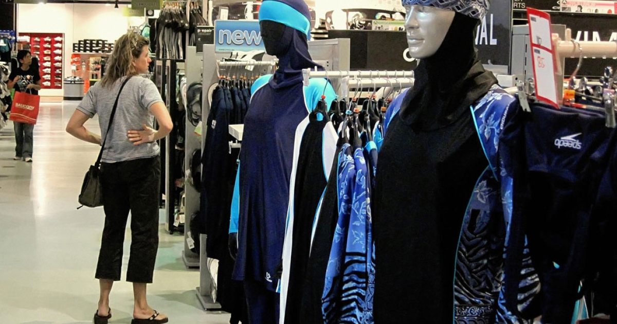 The Islamic full-length swimming suit known as Burqini (or Burkini) sits on display at a sports store in Dubai on August 23, 2009. The three-piece lycra and polyester bodysuit covers the body and hair.</p>