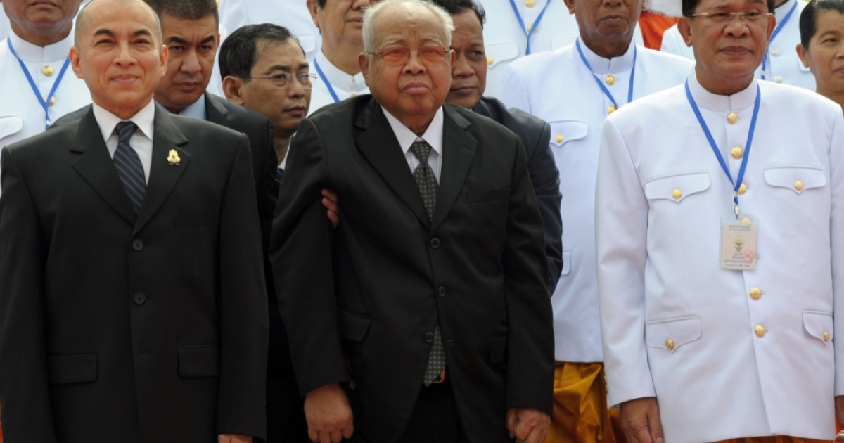 The old guard: Cambodian King Norodom Sihamoni (L),  President of the Cambodian People's Party Chea Sim (C), (and Prime Minister Hun Sen (R) pose for a picture during the first parliament meeting at the National Assembly building in Phnom Penh on Sept. 23, 2013. The country is gripped by political crisis following disputed elections that led to mass protests and violence.</p>