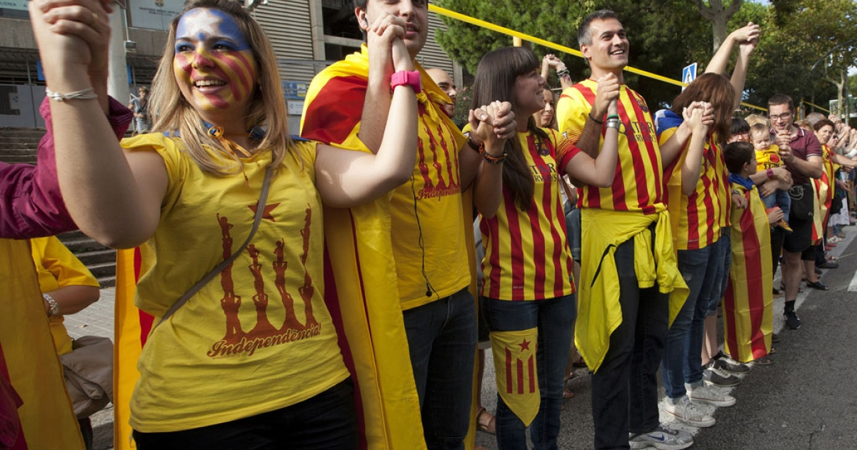 Catalans join hands in Barcelona on Wednesday.</p>