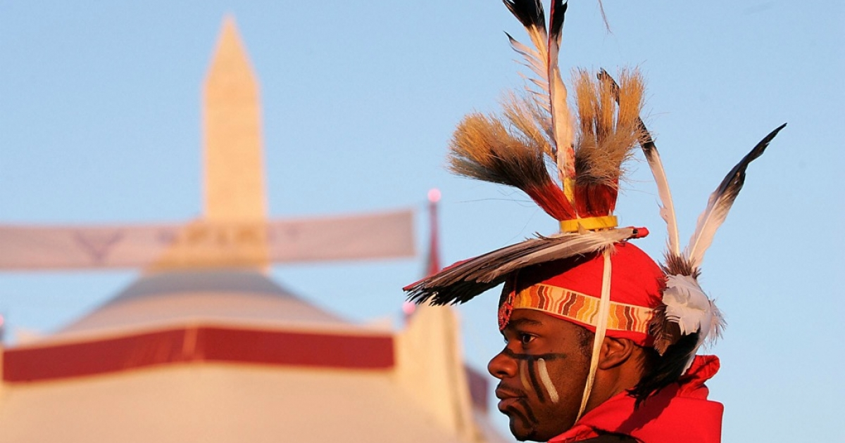 Dennis Redmoon of the Seminole-Cherokee Nation watches during the grand opening procession of the Smithsonian's National Museum of the American Indian in Washington, DC, on Sept. 21, 2004.</p>