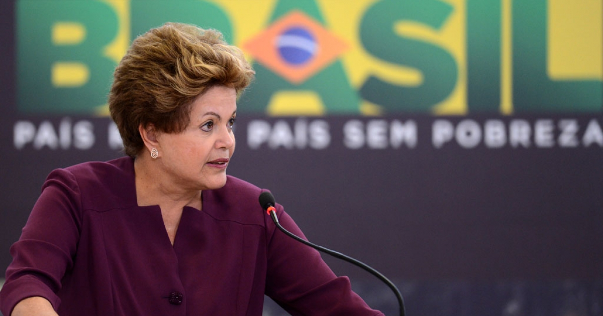 Brazilian President Dilma Rousseff delivers a speech during a ceremony at Planalto Palace in Brasilia, on June 18, 2013.  Rousseff said on Sept. 4, 2013, she wants and explanation and public apology for alleged NSA spying on her private communications.</p>