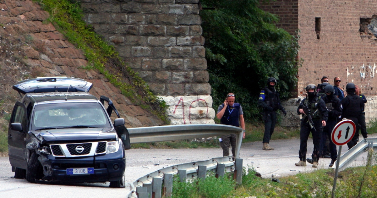 Kosovo and EULEX policemen secure the perimeter where two EULEX vehicles came under fire near the town of Zvecan on September 19, 2013. Gunmen shot dead a member of the European Union's police force in Kosovo's flashpoint northern region, in the first deadly attack on the mission since its creation five years ago.</p>