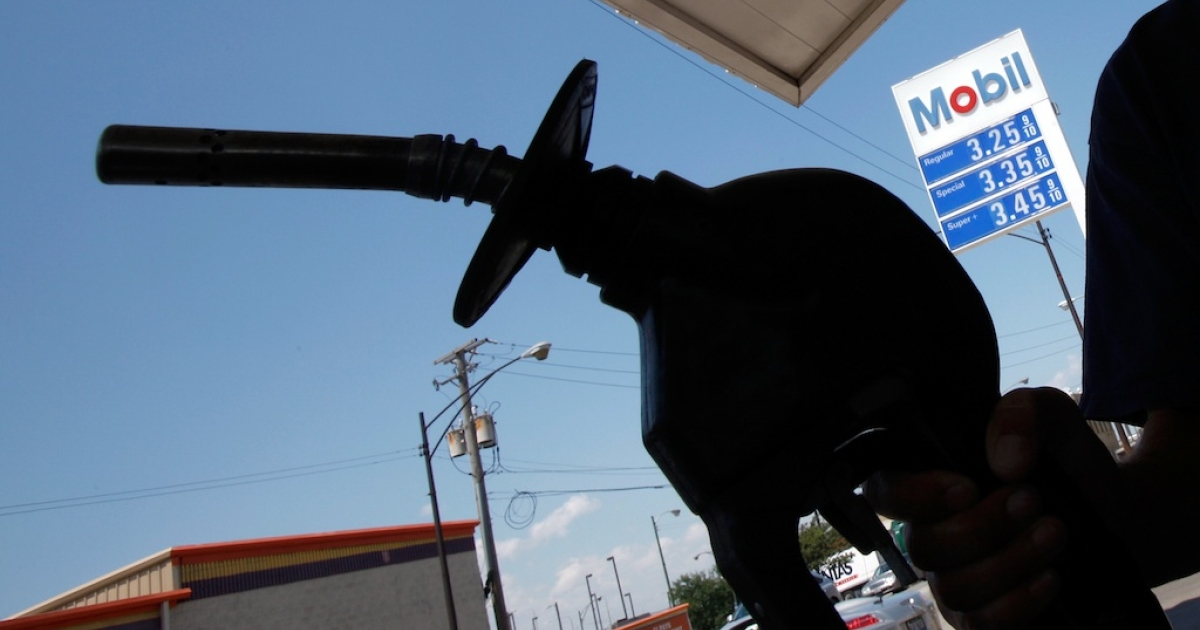 A car owner fills up at an Exxon Mobil gas station in Chicago on July 29, 2010.</p>