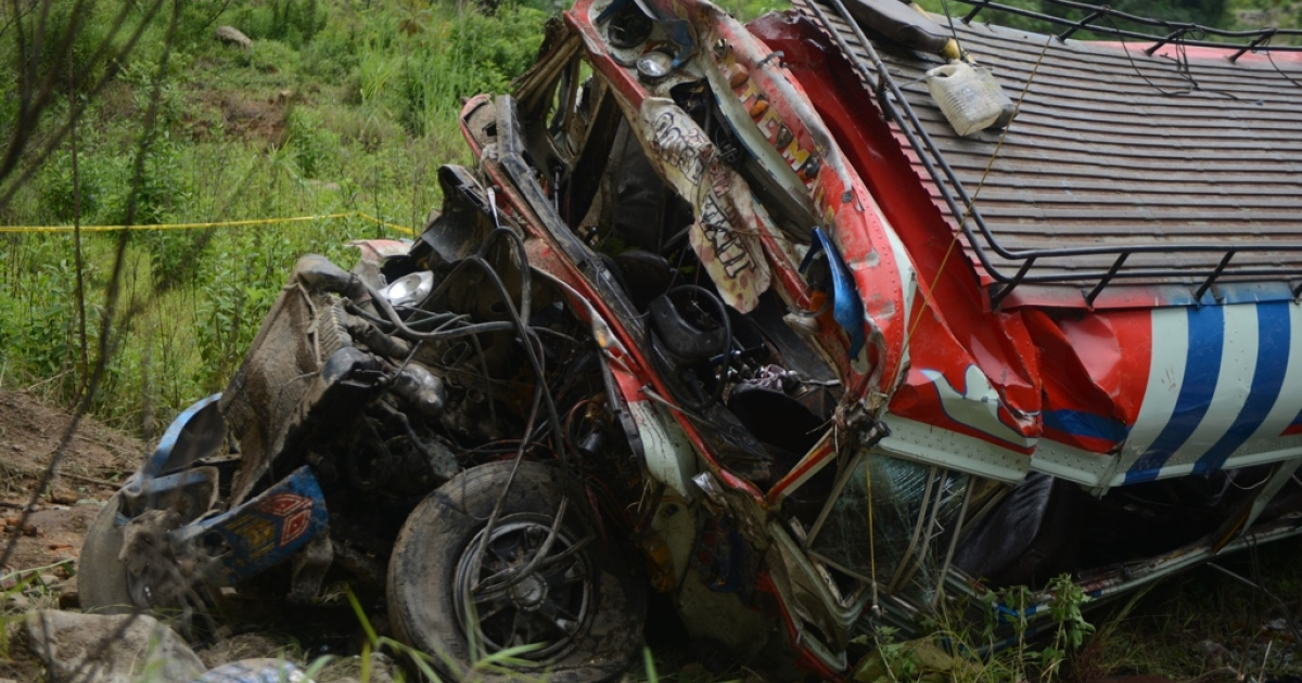 The wreckage of a bus that plunged 230 feet after careening off a road in San Martin Jilotepeque, 40 miles west of Guatemala City, killing dozens of passengers.</p>