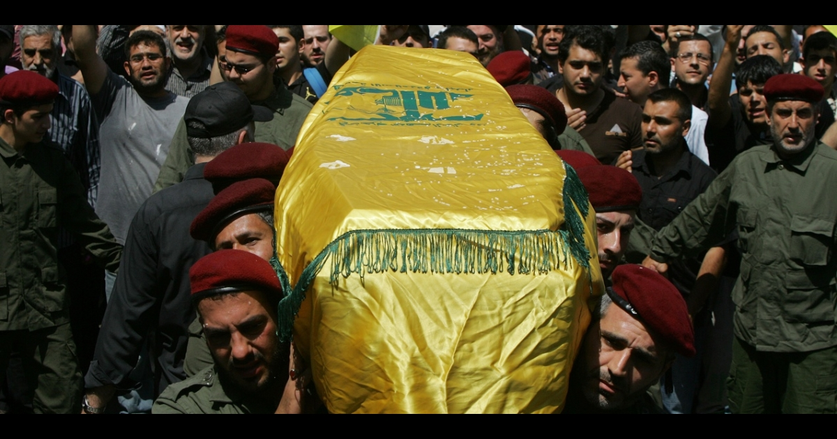 Members of Lebanon's Hezbollah carry the coffin of their comrade Hussein Ahmed Abul Hassan during his funeral in southern Beirut in May. How Hezbollah might respond to US strikes on Syria is a cause for concern for war-weary Lebanese.</p>