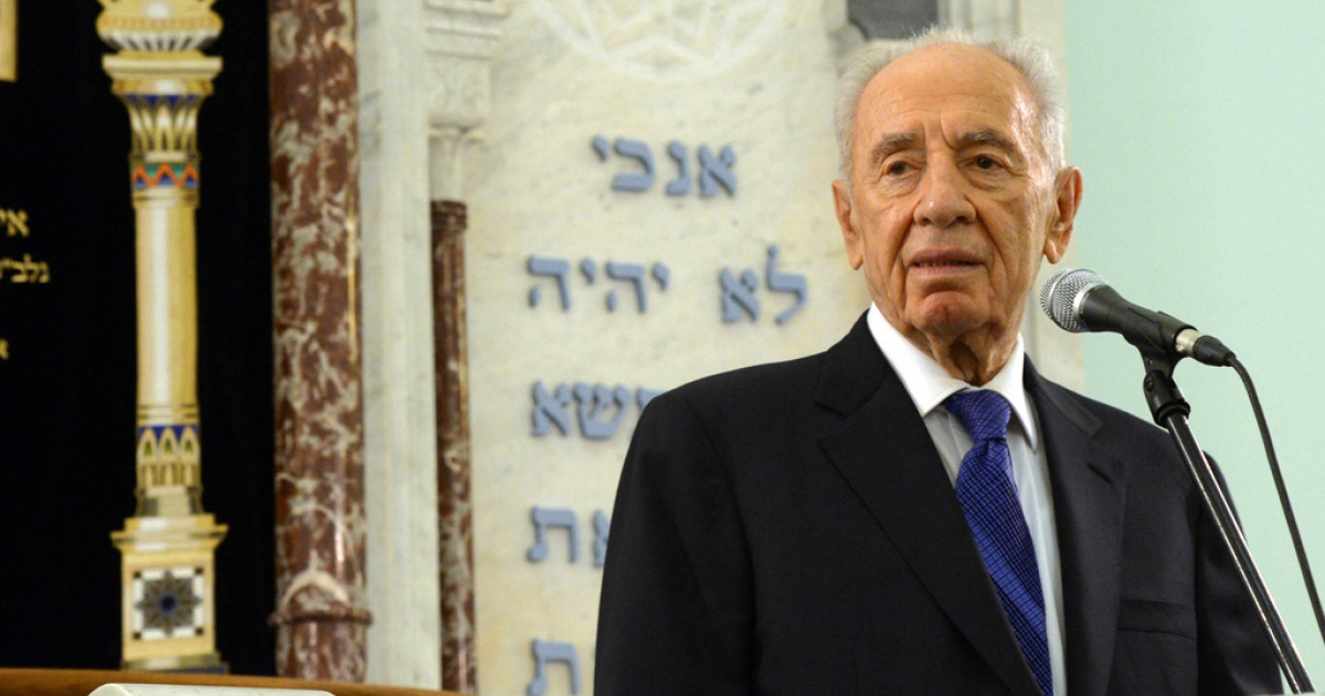Israeli President Shimon Peres speaks during a service in a Jewish Synagogue in Riga, Latvia.</p>