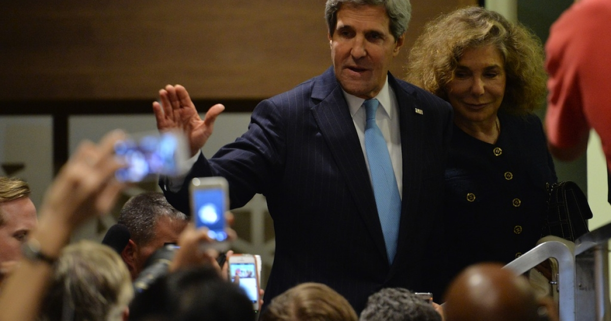 US Secretary of State John Kerry waves to the media outside the UN Security Council on Sept. 27, 2013 after the 15-member body approved a resolution requiring Syria to give up its chemical weapons.</p>