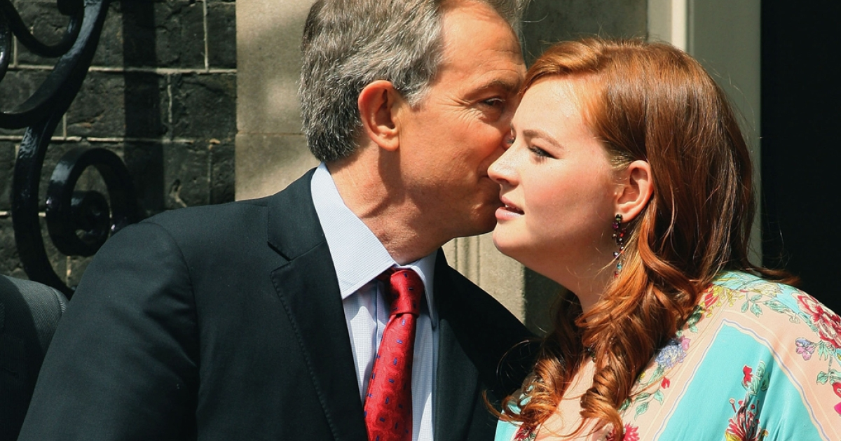 Tony Blair kisses his daughter, Kathryn, before leaving his Downing Street residence for the last time as prime minister on June 27, 2007, in London.</p>