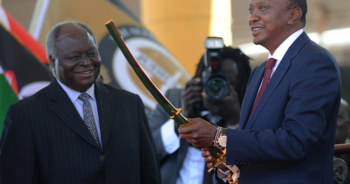 Kenya's fourth president Uhuru Kenyatta receives a sword as a symbol of authority during his inauguration at in Nairobi on April 9, 2013.</p>