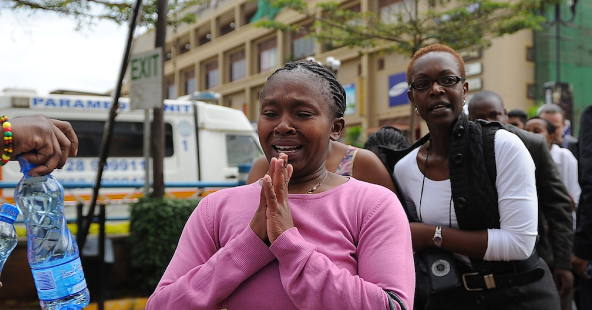 A woman who had been held hostage reacts following a security operation at an upmarket shopping mall, where suspected terrorists engaged Kenyan security forces in a drawn out gun fight on September 21, 2013 in Nairobi.</p>