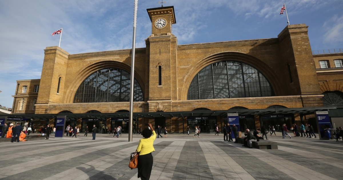 Members of the public walk through the newly opened King's Cross Square on September 26, 2013 in London, England. The opening of the square, which reveals the original facade of King's Cross station for the first time in 150 years, marks the final stage in the 550 million GBP redevelopment of the station.</p>