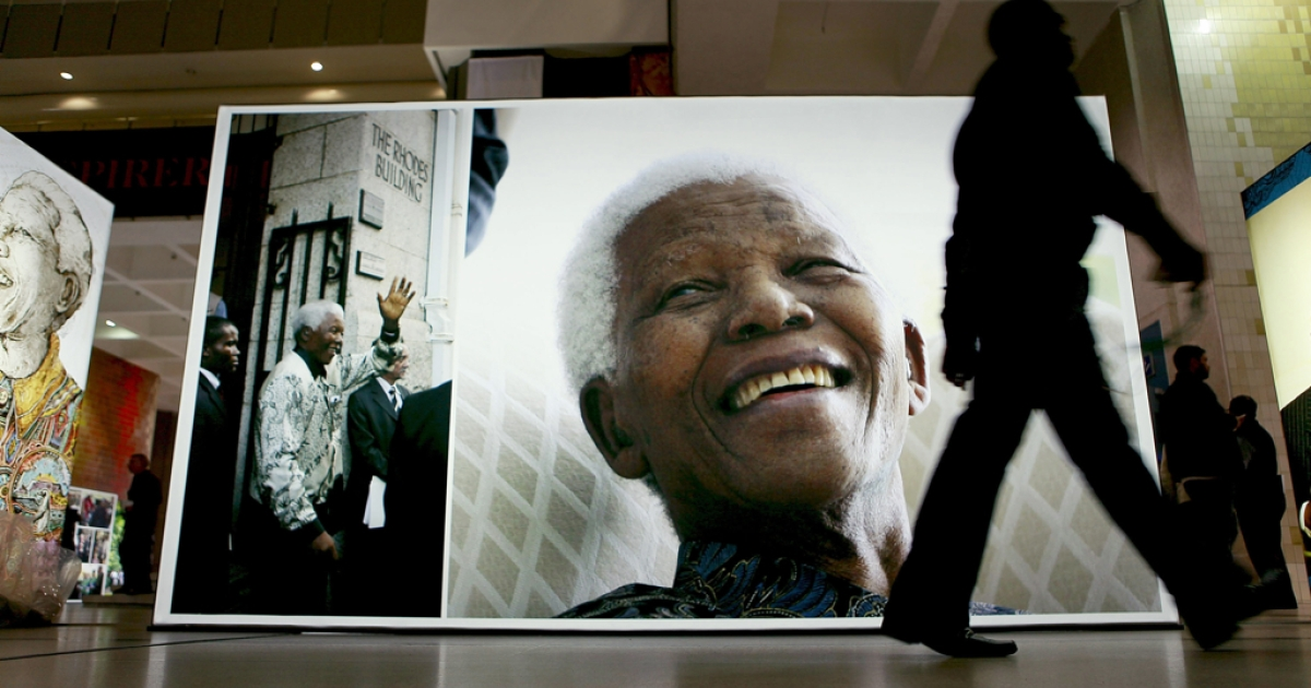 A person walk past a display at the Cape Town Honours Nelson Mandela exhibition in Cape Town, South Africa.</p>