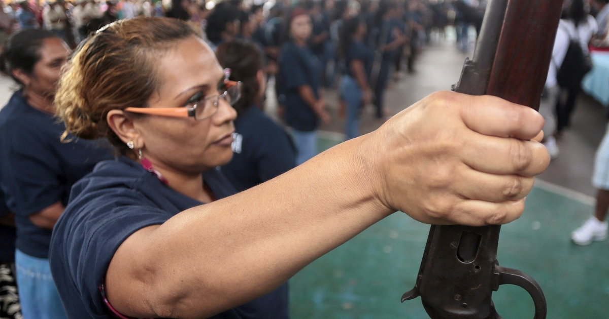 Mexican women, like these in Acapulco, have joined community vigilante militias taking up arms in self-defense.</p>