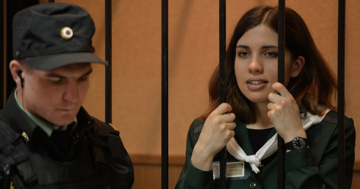 Nadezhda Tolokonnikova looks on while standing in the defendant's cage in Zubova Polyana, in the Republic of Mordovia.</p>