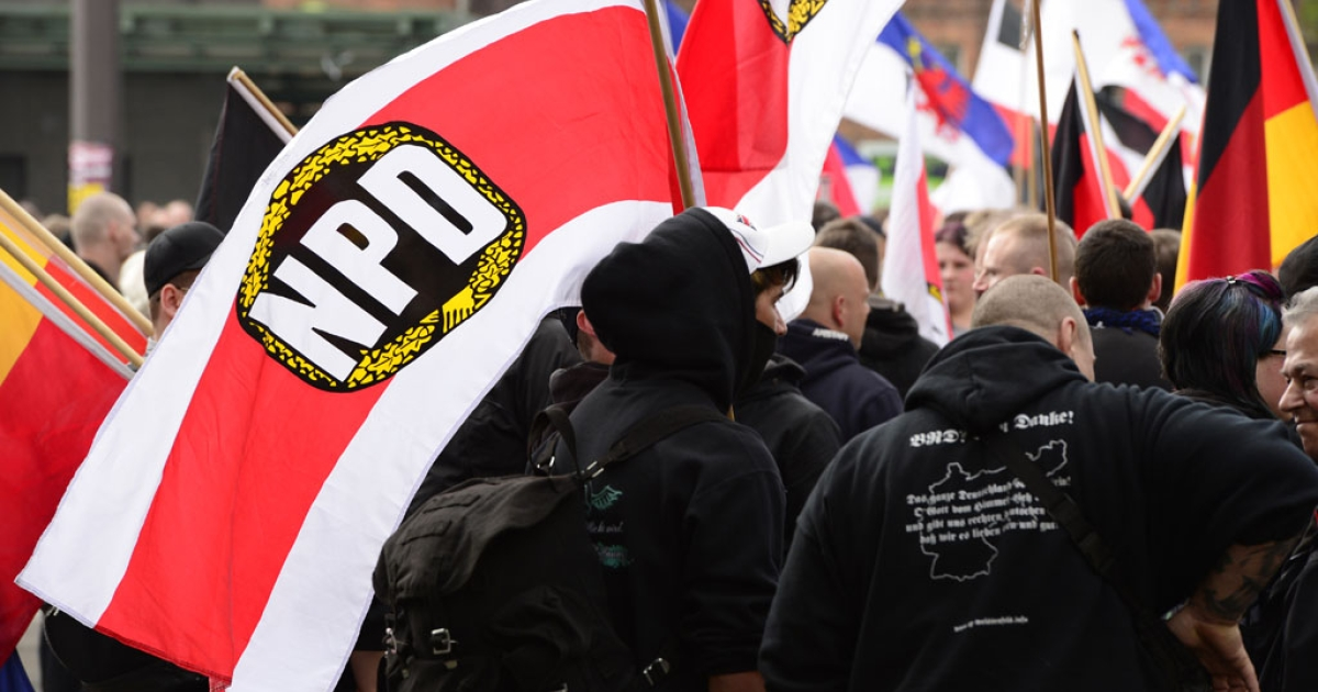 Supporters of Germany's far-right National Democratic Party (NPD) wave flags as they take part in a demonstration on May 1, 2013 in Berlin.</p>